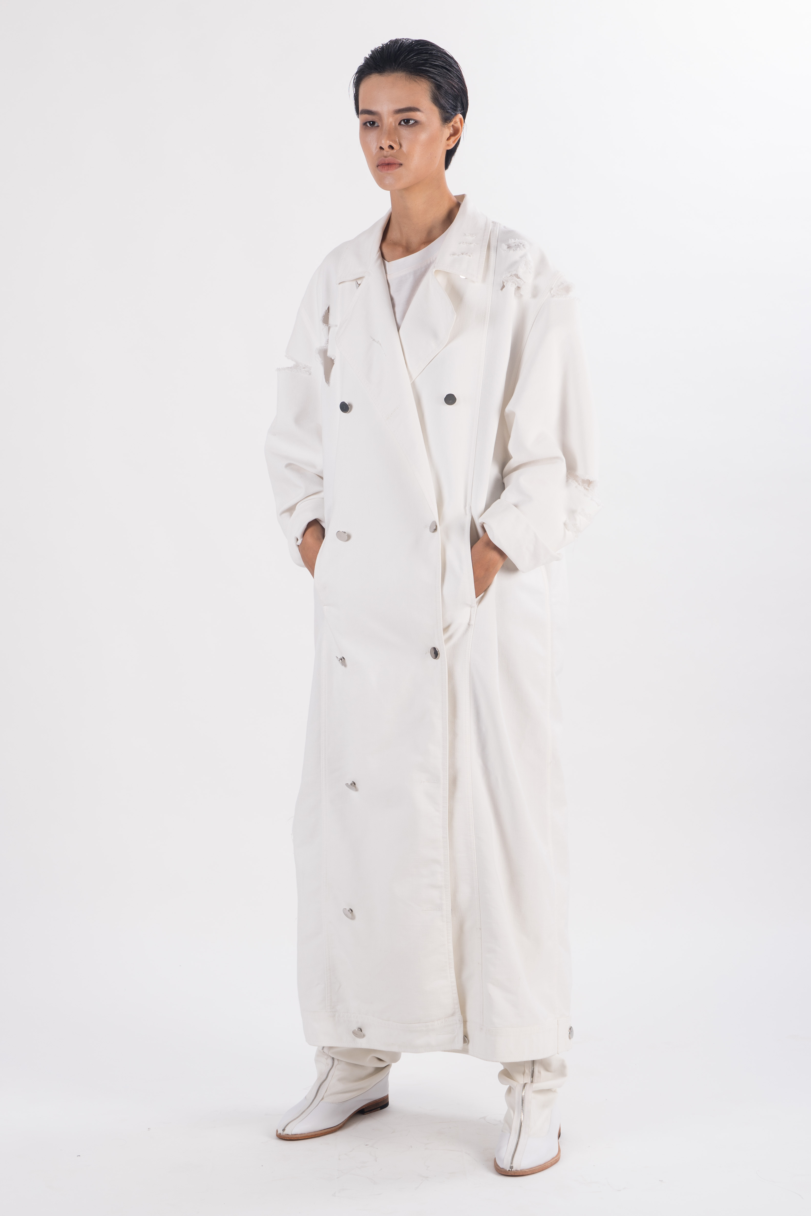 White  double breasted long heavy cotton coat with rips on shoulder and sleeves