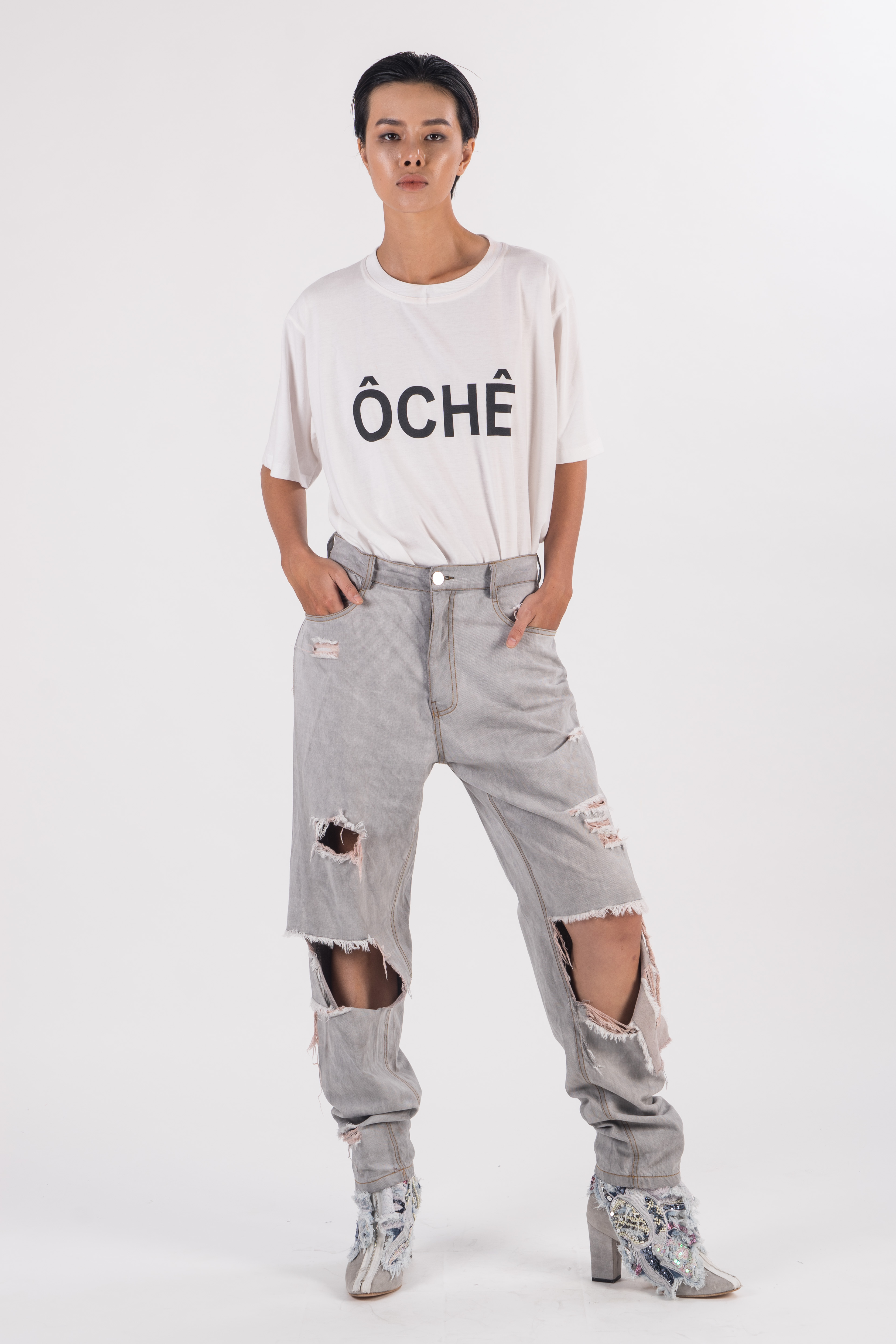 Light grey distress denim boyfriend pants with tears