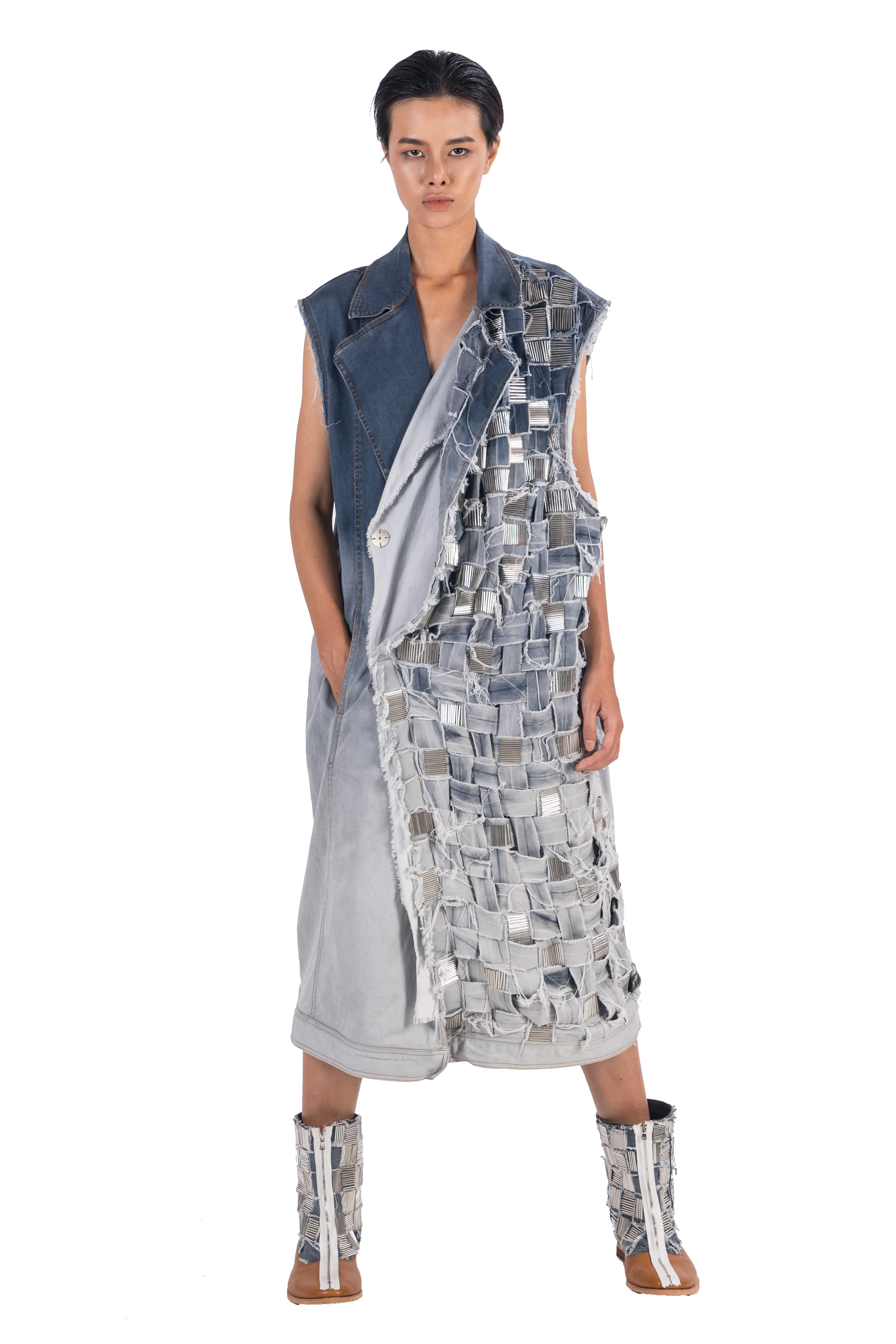 Long sleeveless distressed denim double breasted coat with hand woven front left handside panel with hand applied embellishement