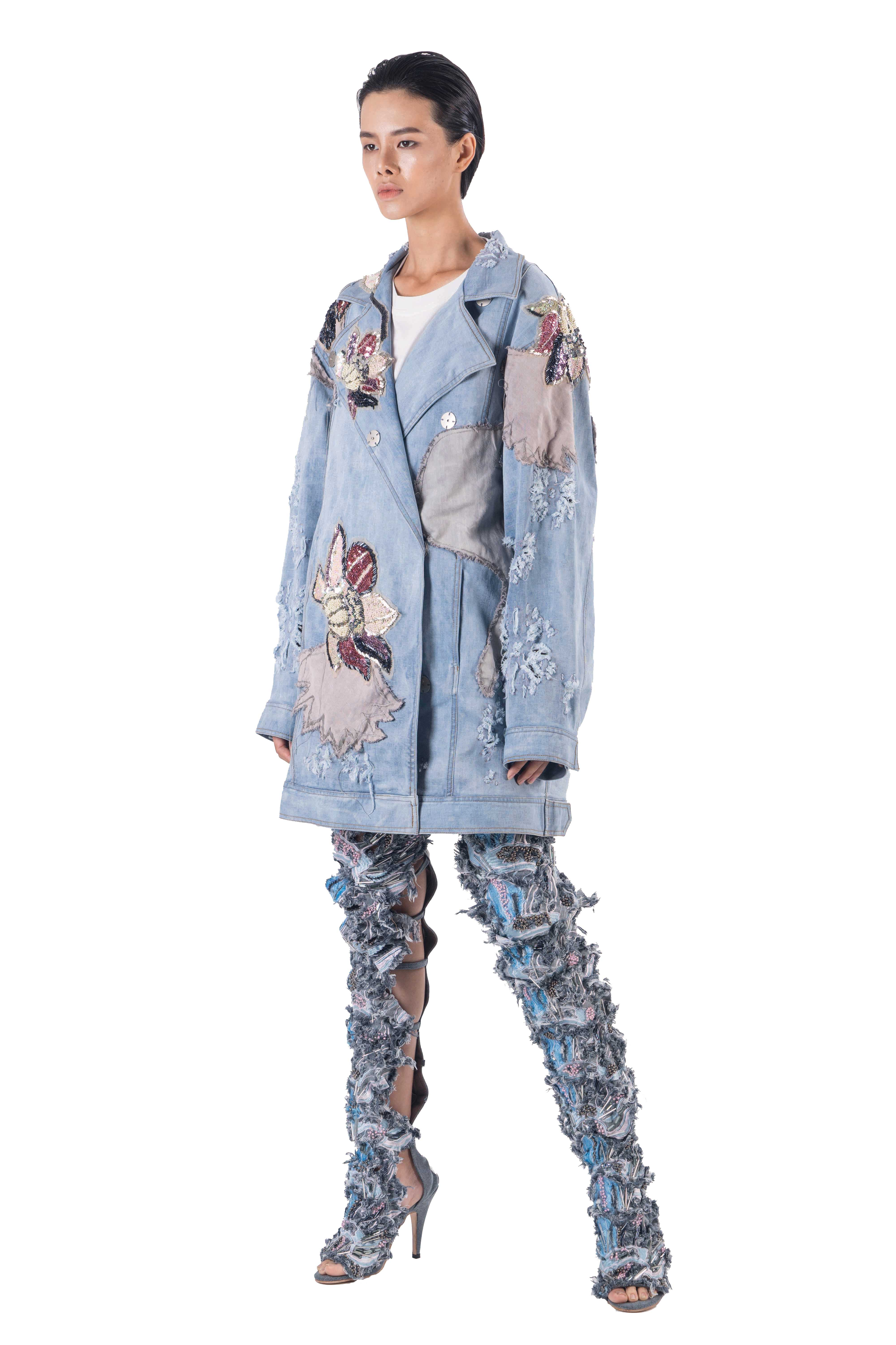 Blue distressed denim long jacket with ripped details, sequined lotus flowers and embellishment