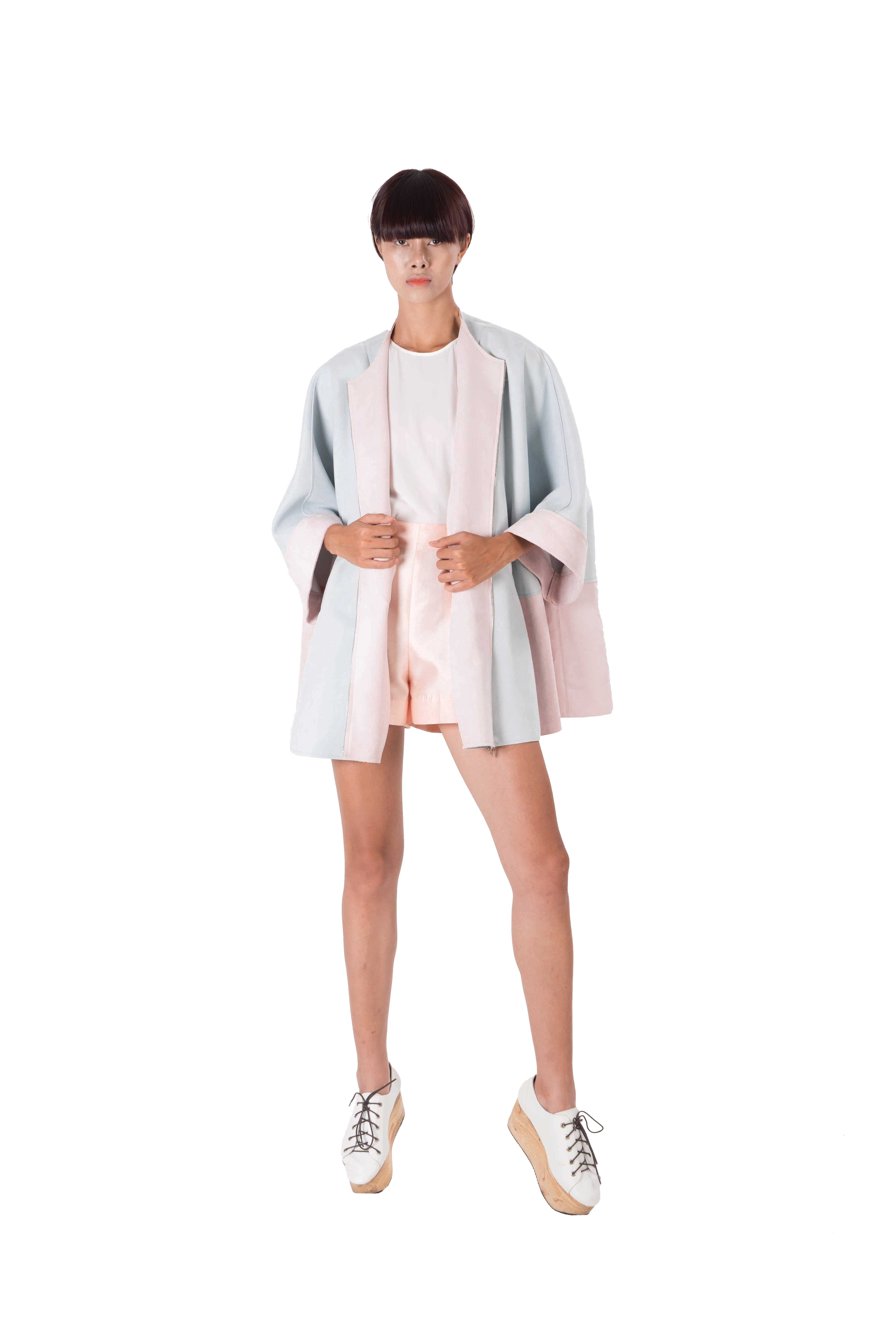 Contrasting blue and pink batwing jacket with laser cut detailing
