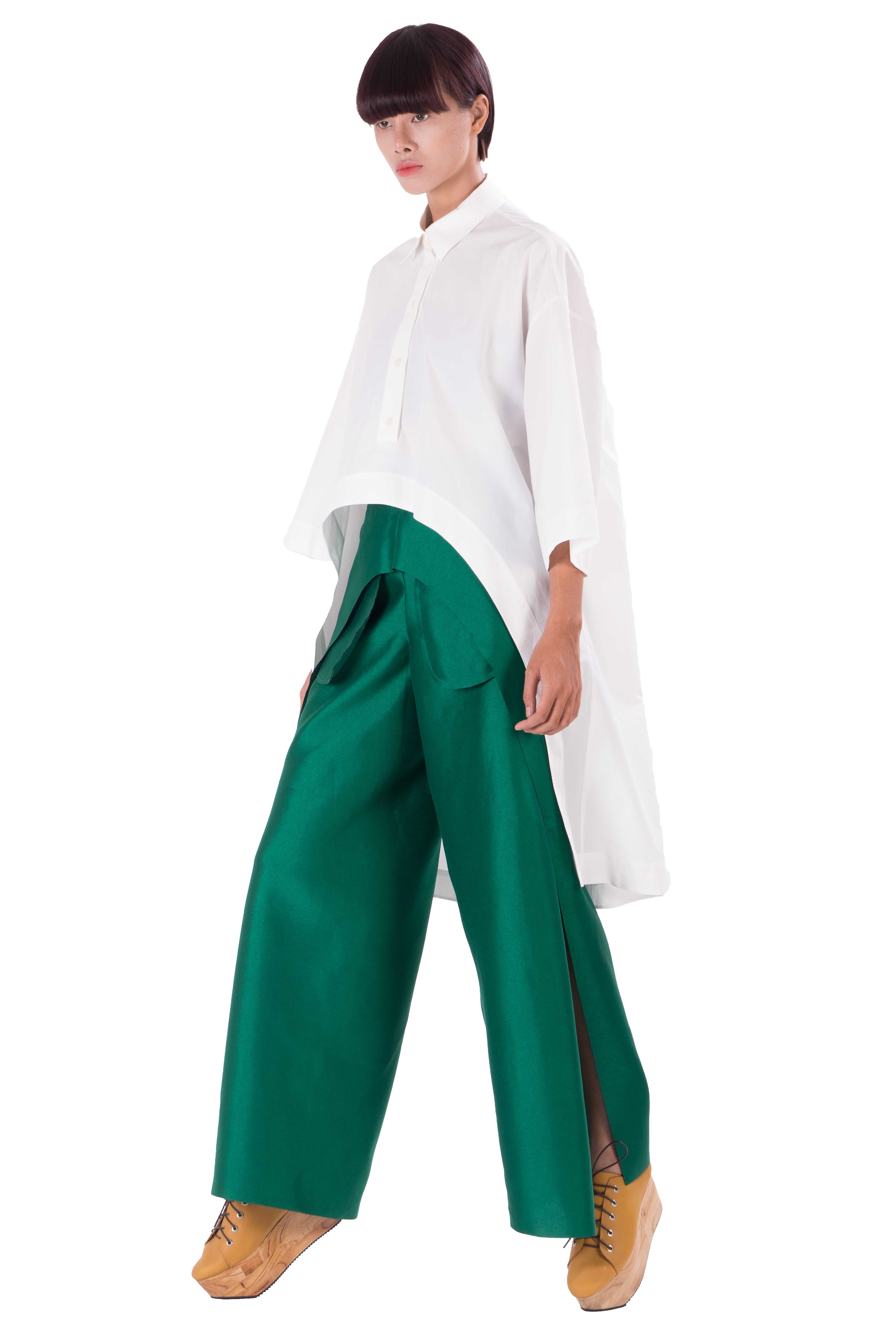 Green taffeta trousers with laser cut edges