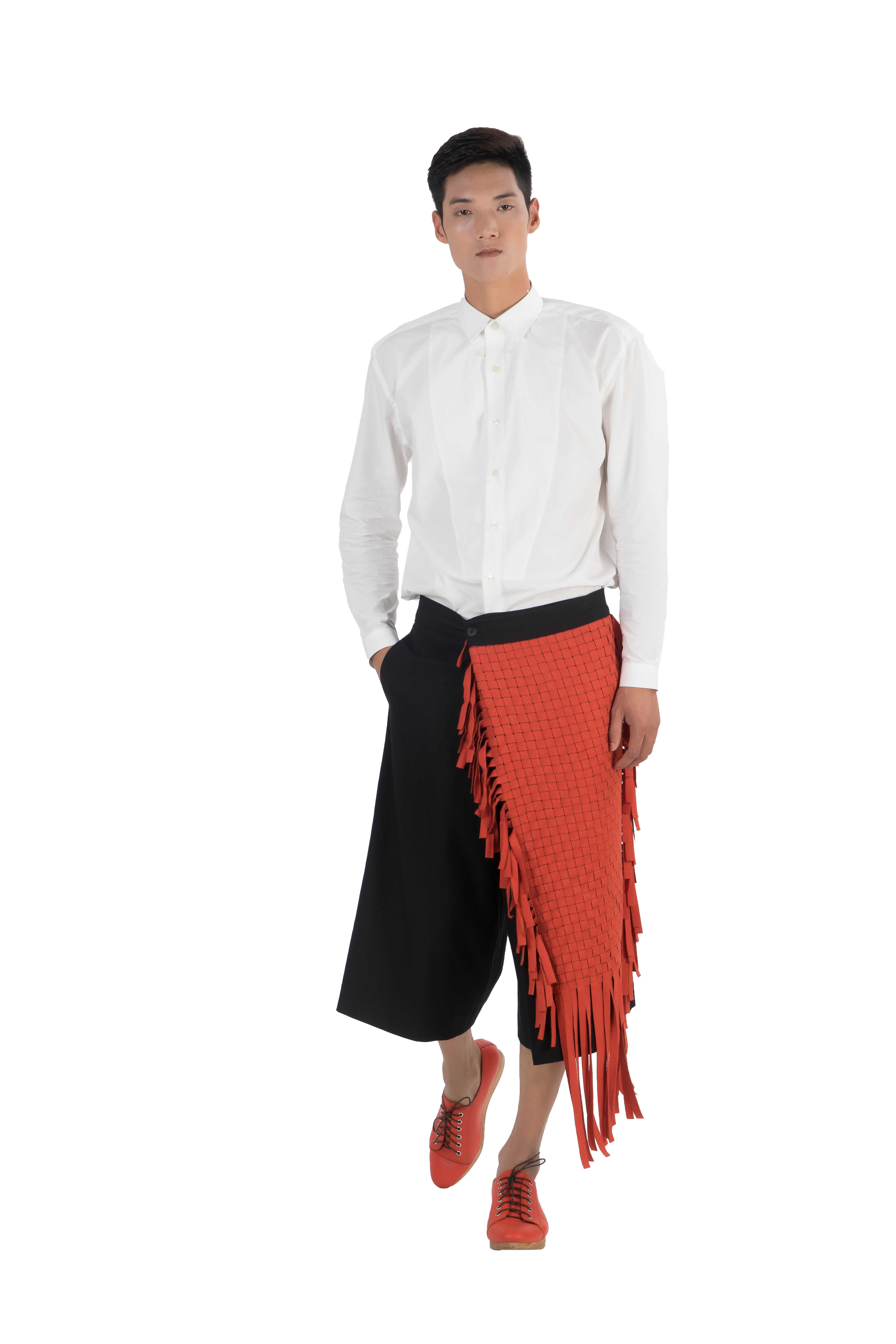 Wrap style knee length wide shorts with orange wool blend woven panel and fringes