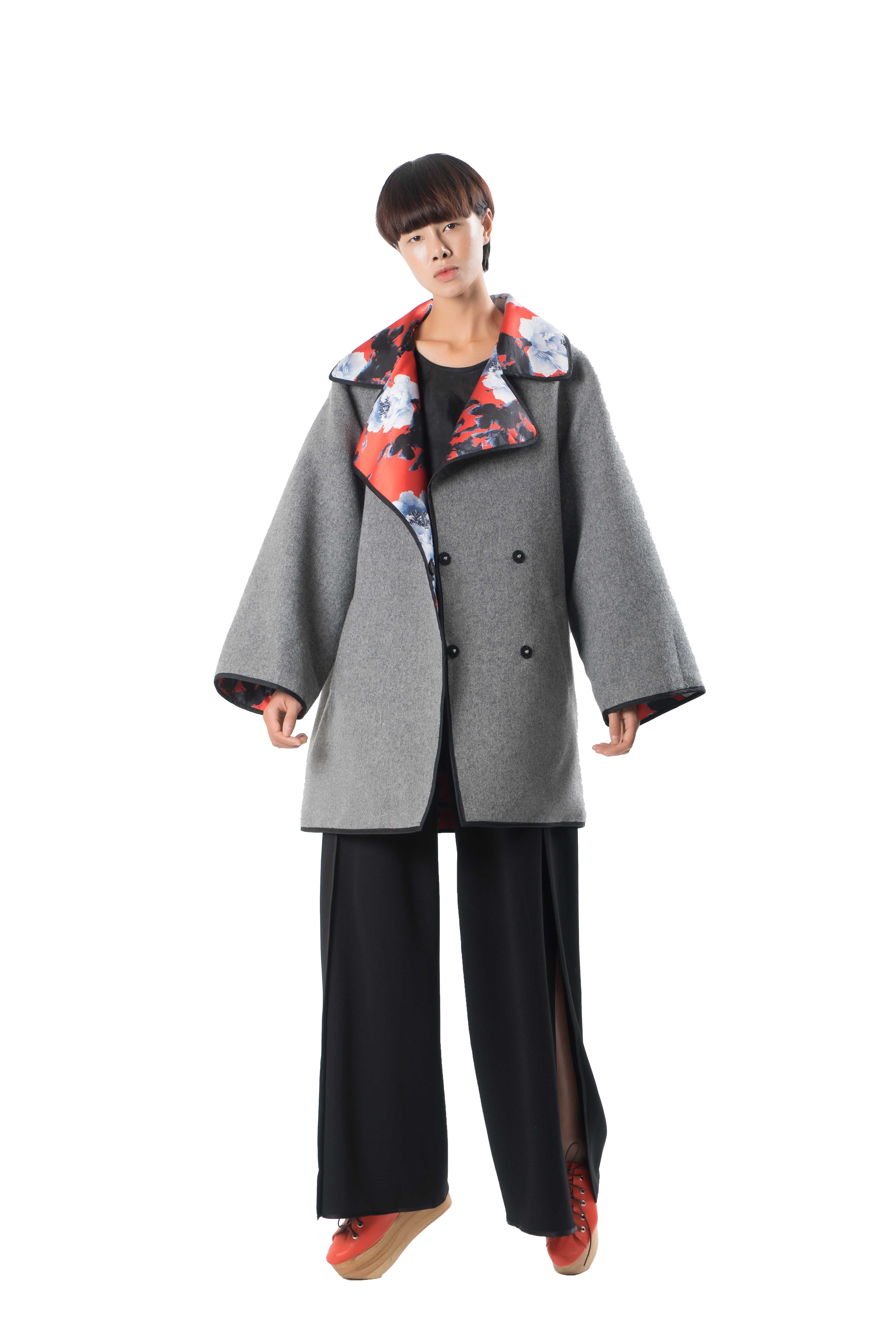 Reversible loose fit coat with piping.